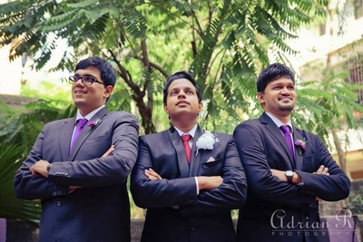 Groomsmen dressed with purple ties and purple lapels for the wedding day