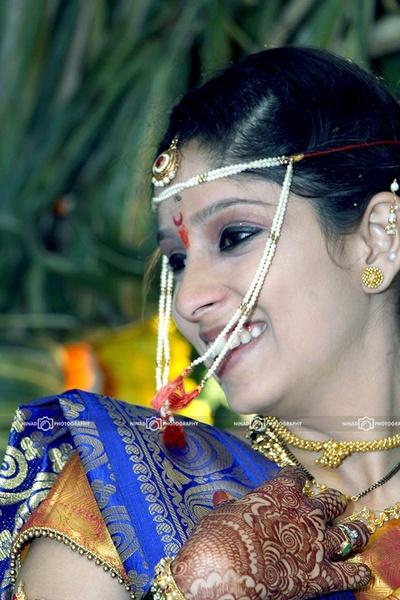 Navaari silk saree embedded zari woven details, styled with traditional gold jewellery
