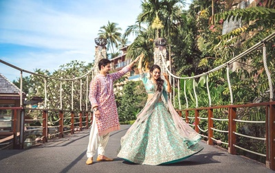 Complementing each other with pastel shade outfits for the mehendi ceremony.
