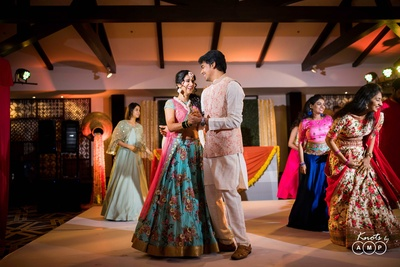 Candid wedding photography of the bride and groom during the sangeet function