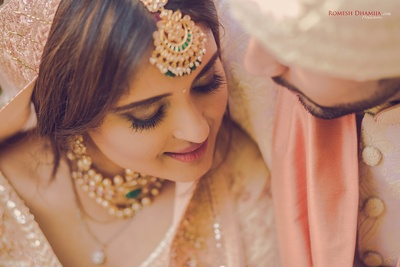 Intimate capture of the bride and groom together for their post wedding photoshoot