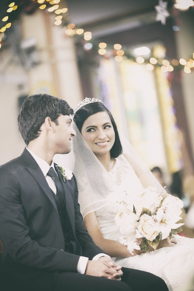 A black three piece suit and tie with a crisp white shirt to offset the bride's stunning white bridal outfit
