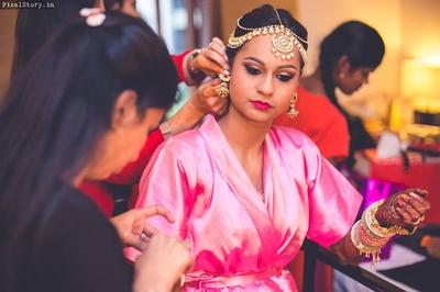Bride Jeenal getting ready for her Mehendi ceremony wearing beautiful multi string tikka.