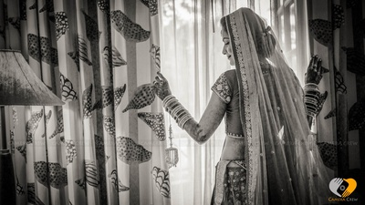 Netted indian veil adorned with glitzy border buttis