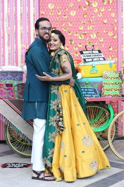 Couple posing at their mehendi ceremony