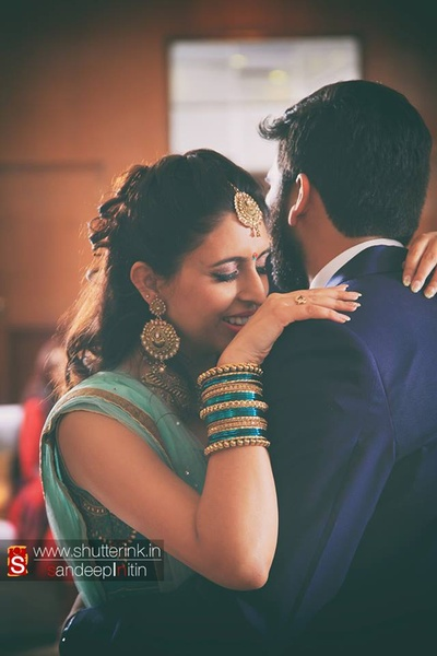 Stunning bride, charmed by her husband-to-be flattering in a crown french braid hairstyle