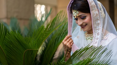 The bride looks ethereal in a white and pastel ensemble paired with polki jewellery.