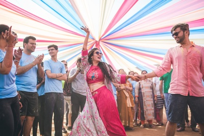 a candid capture of the bride and groom dancing at the mehendi ceremony