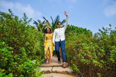 Bride and groom enter their beach side wedding functions