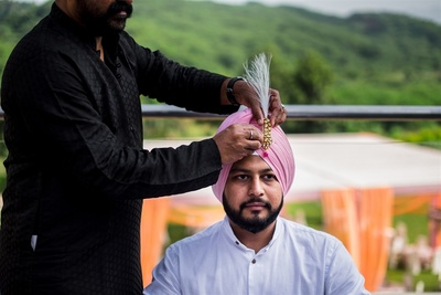 the groom getting ready for the wedding