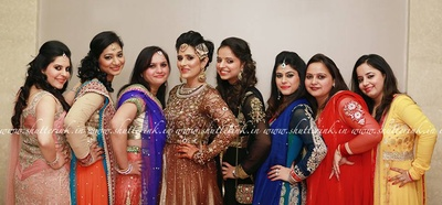 Bride sharing a photo moment with her bridesmaids