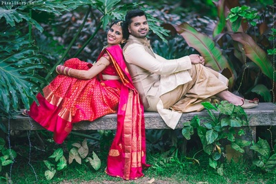 Pratibha looking beautiful in this red and gold South Indian Saree and Ashwin dressed royally in off white Bandhgala and Dhoti