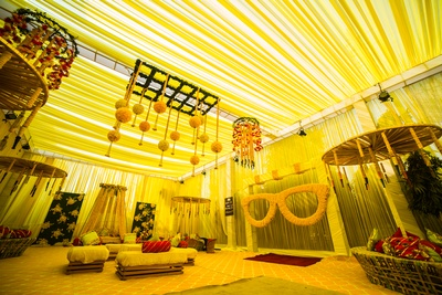 Canopy, oversized glasses, floral chandeliers and casual seating for the mehendi ceremony