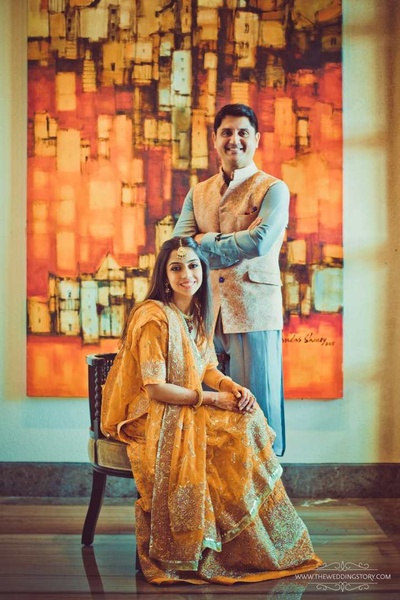Bride and groom pose for their pre wedding shoot during the haldi ceremony