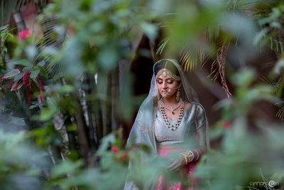 Bridal pre wedding shoot of Tanvi in her powder blue choli and fuschia lehenga paired with a net dupatta