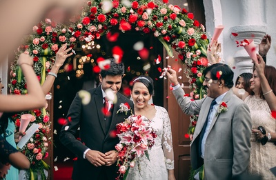 Red flower cluster decoration to match the and red and white wedding theme