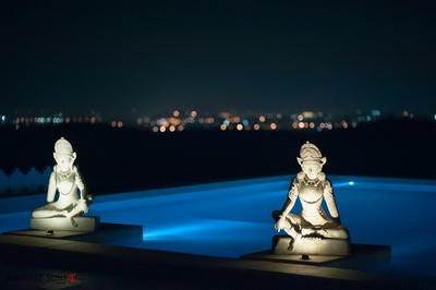 Swimming pool at Fatehgarh is enhanced by these marble carved sculptures