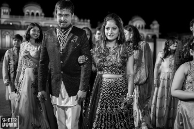 bride and groom entering the sangeet ceremony