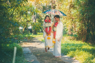 Traditional bride and groom pose together post wedding