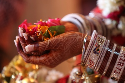 A beautiful close-up of the bride's hand, holding petals of flowers