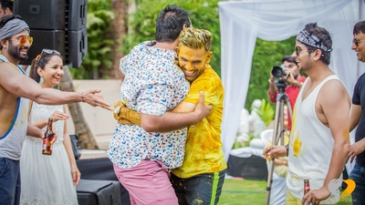 Dressed in a yellow T-shirt and casual shorts for his drenching mustard colored Haldi ceremony