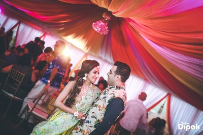 Lost in their world, the bride and the groom in a beautiful couple shot at Mehndi ceremony