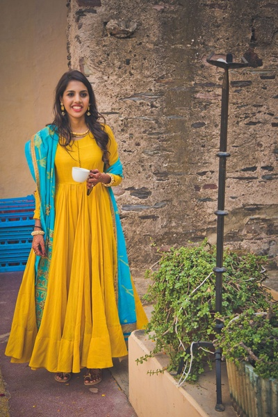 Mustard yellow flared floor-length anarkali dress with aqua printed dupatta with gold beads and sequins for the mehendi function