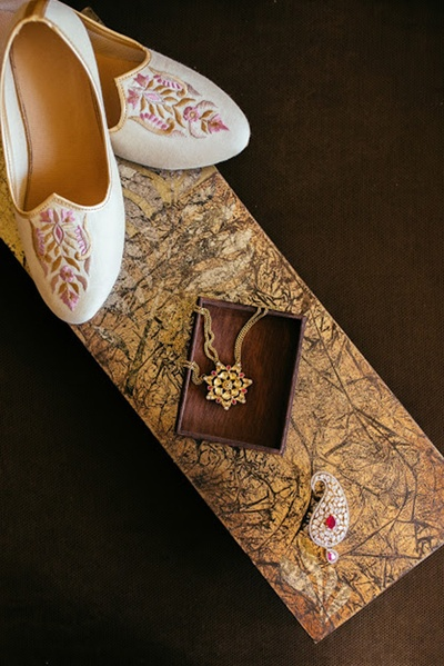 the groom's footwear, necklace and kalgi