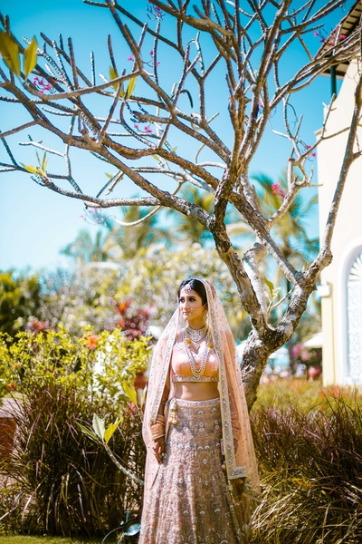 The Photo Diary captures Kiran ready for the wedding function in a peach and silver lehenga