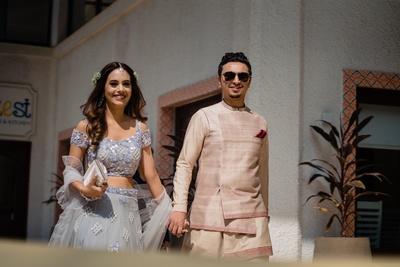the bride and groom entering a pre wedding function