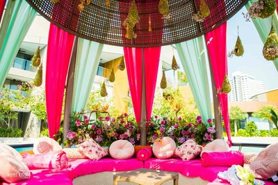 A cute and chic diwan-style seating arrangement in different hues of pink!