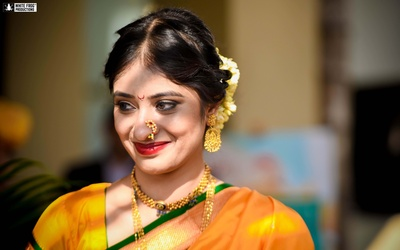 The bride looks radiant in this mango and green traditional saree paired with gold jewellery.