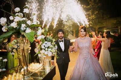Bride and groom enter the wedding reception at Amanta Lawns, Delhi