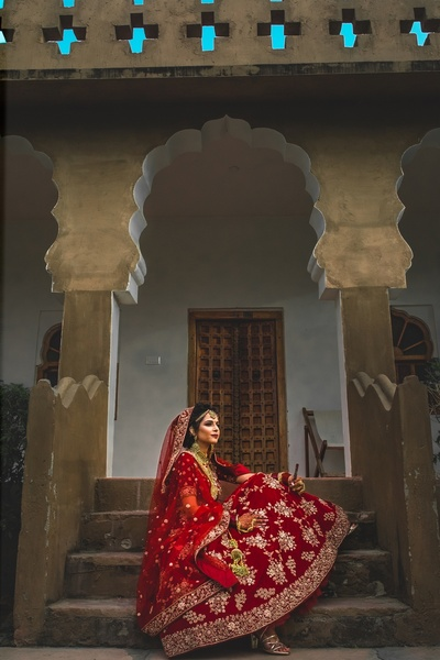 the beautiful bride in a stunning red lehenga