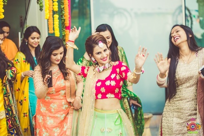 Bride dancing at her mehndi ceremony at Bella Vista, Chandigarh