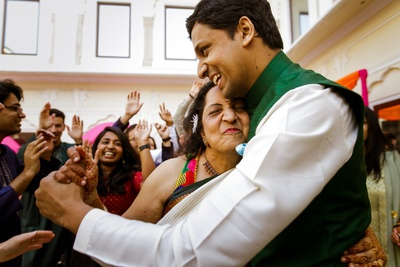 The groom dancing  with a family member