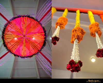 Wedding venue decorated with drapes, yellow and orange Marigold flowers