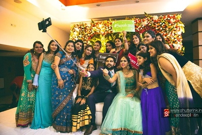 Wedding Groupfie with props and a selfie stick, recaptured by Shutterink Photography