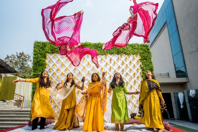 The bride and her bridesmaids having some fun at the haldi ceremony.