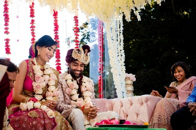 bride and groom in the wedding mandap as the ceremony progresses