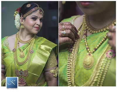Parrot green kanjivaram saree with gold weaves and layers of south Indian gold jewellery and gajra adorned braided hairstyle