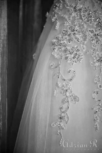 Netted white wedding gown embellished with embroidery and faux pearls