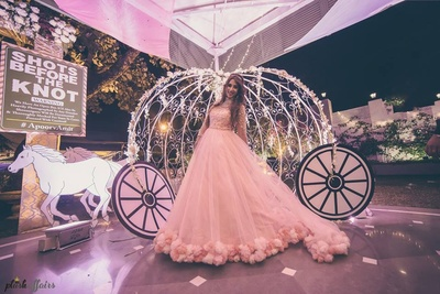 Dressed up in a baby pink wedding gown by Christina WU.
