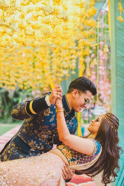 Candid capture of the bride and groom during their mehndi function at Oberoi, Chandigarh