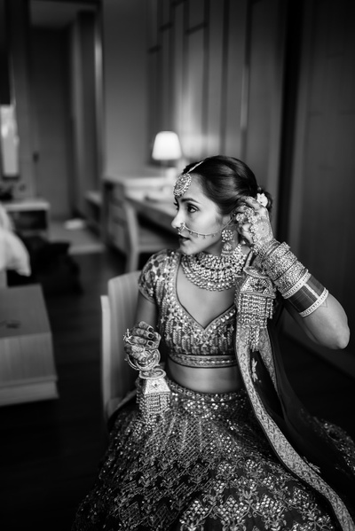Black and white photography of the bride getting ready for the wedding ceremony