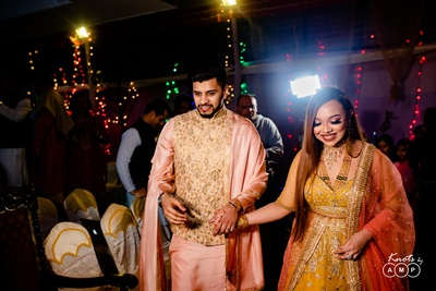 The groom escorting his beautiful to-be-bride to the sangeet venue.