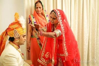 An elegant red net ghagra choli with simple gold motifs