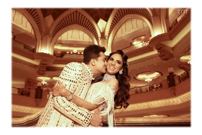Bride and groom pose together during their sangeet ceremony