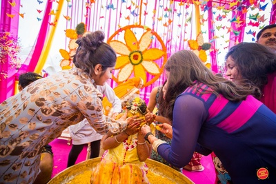 The bridesmaids smearing the bride with haldi