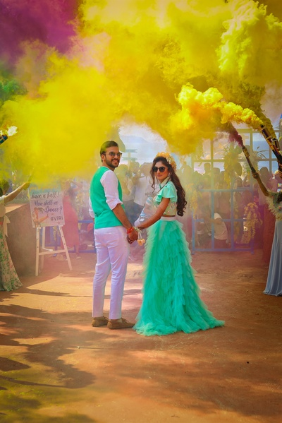This couple is going all out with smoke bombs at their beach party!